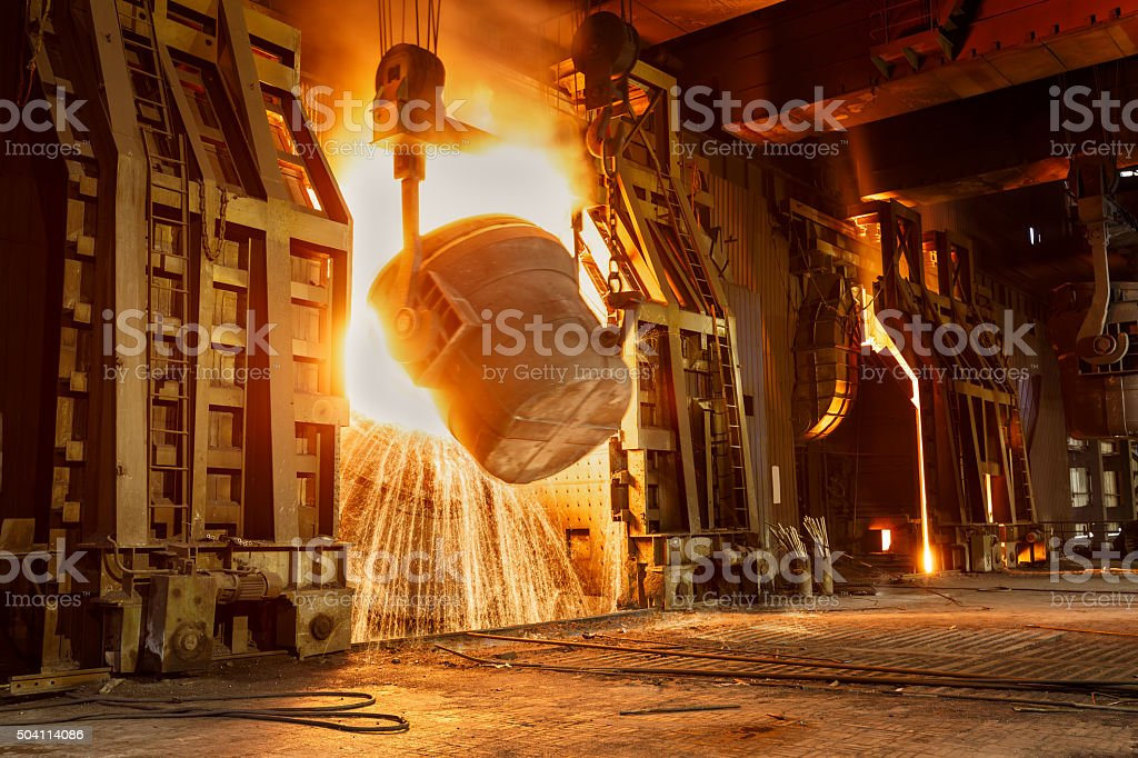 Metal smelting furnace in steel mills stock photo