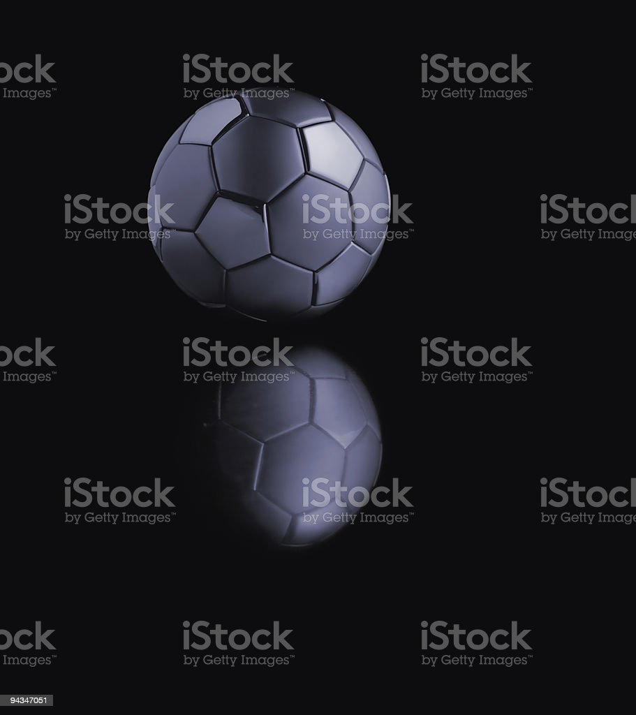 Metal soccer ball in the dark royalty-free stock photo