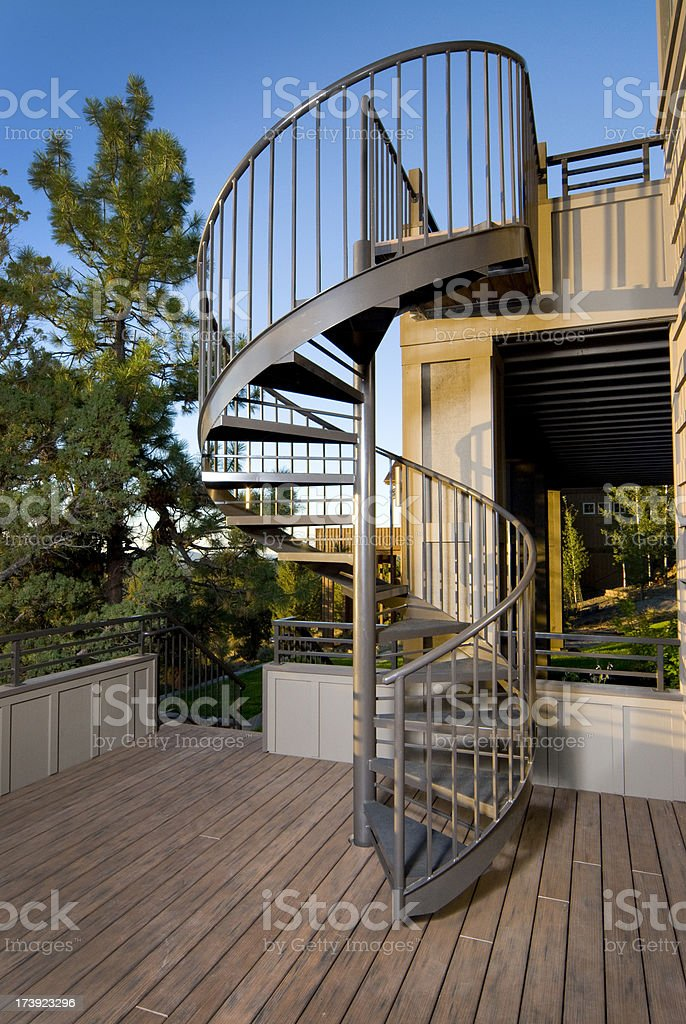 Metal spiral stair case outside stock photo
