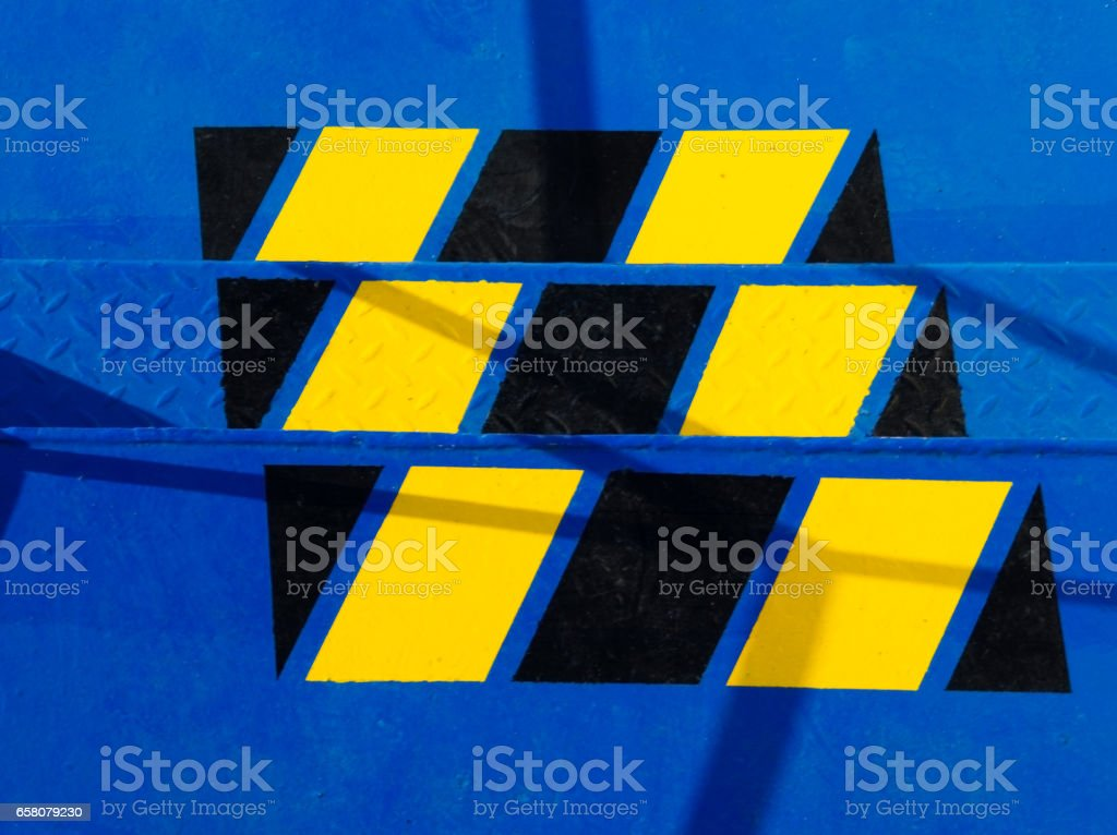 metal staircase painted in blue with warning watch your steps signs stock photo