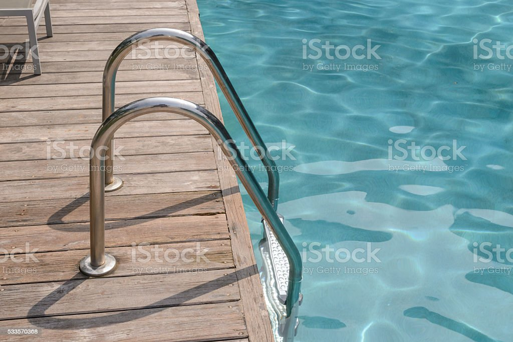 Metal staircase to the entrance swimming pool stock photo