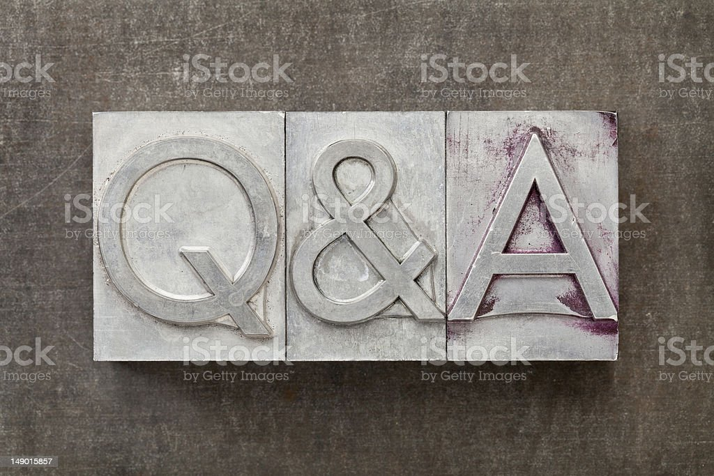 A metal stamp with Q & A on it royalty-free stock photo