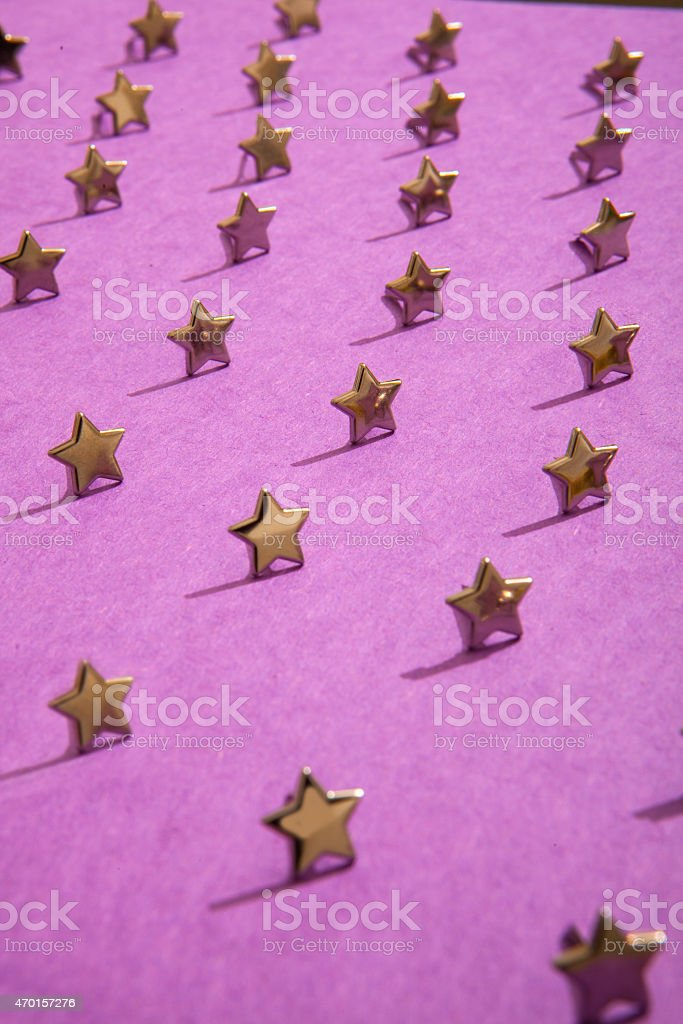 Metal stars on a field of purple. stock photo