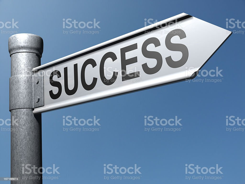 Metal street pole with success sign on blue background stock photo