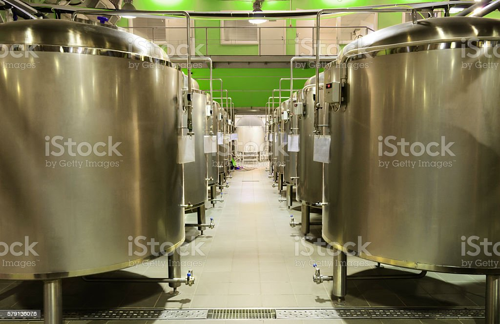 Metal tanks for the fermentation of beer stock photo