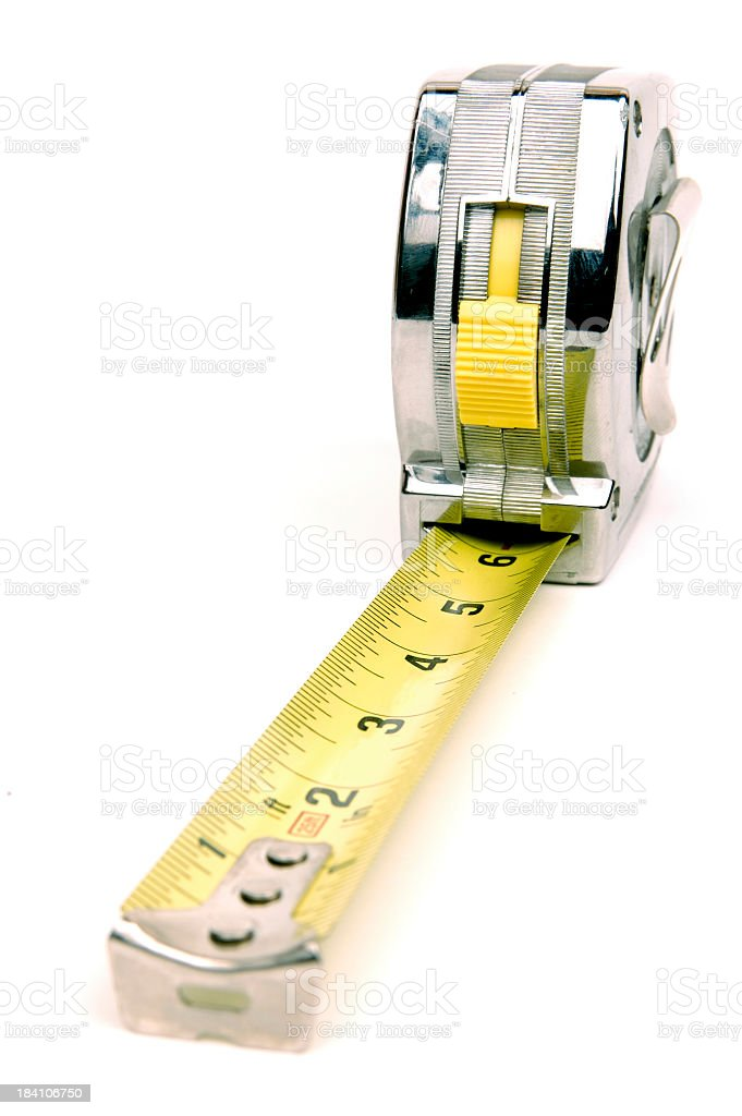 Metal tape measurer with yellow tape stock photo