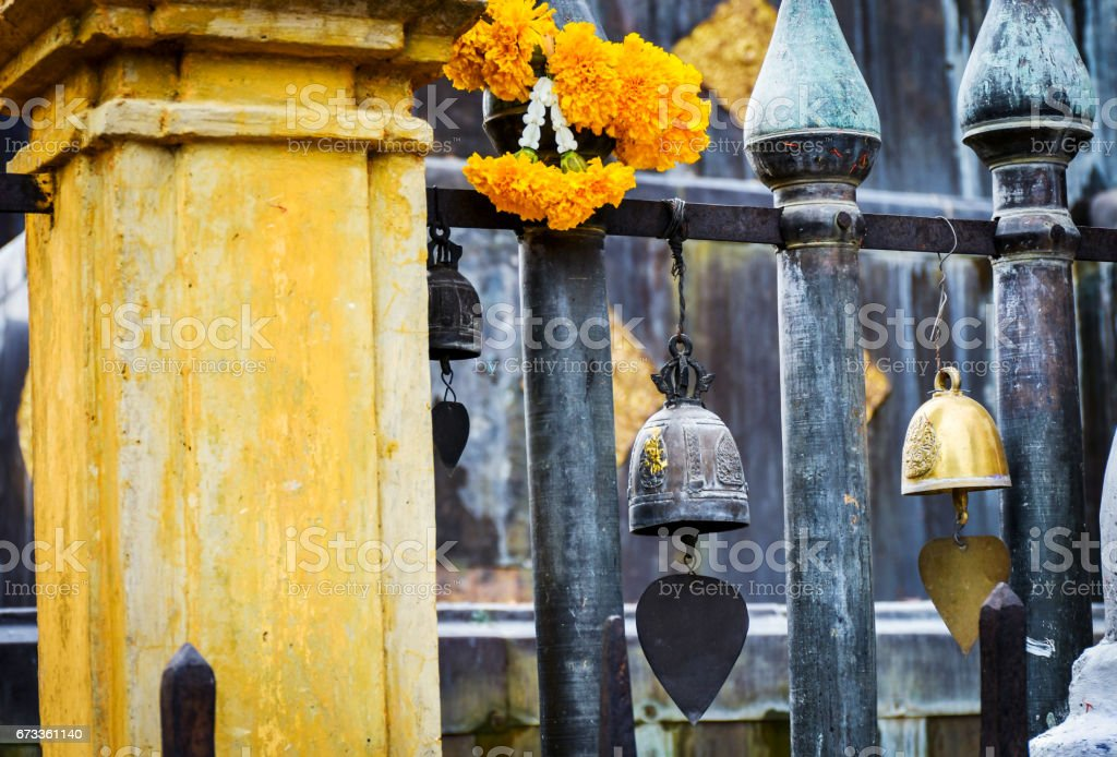 Metal temple bells in temple of Thailand. stock photo