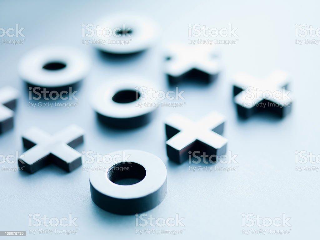Metal tic-tac-toe game pieces stock photo