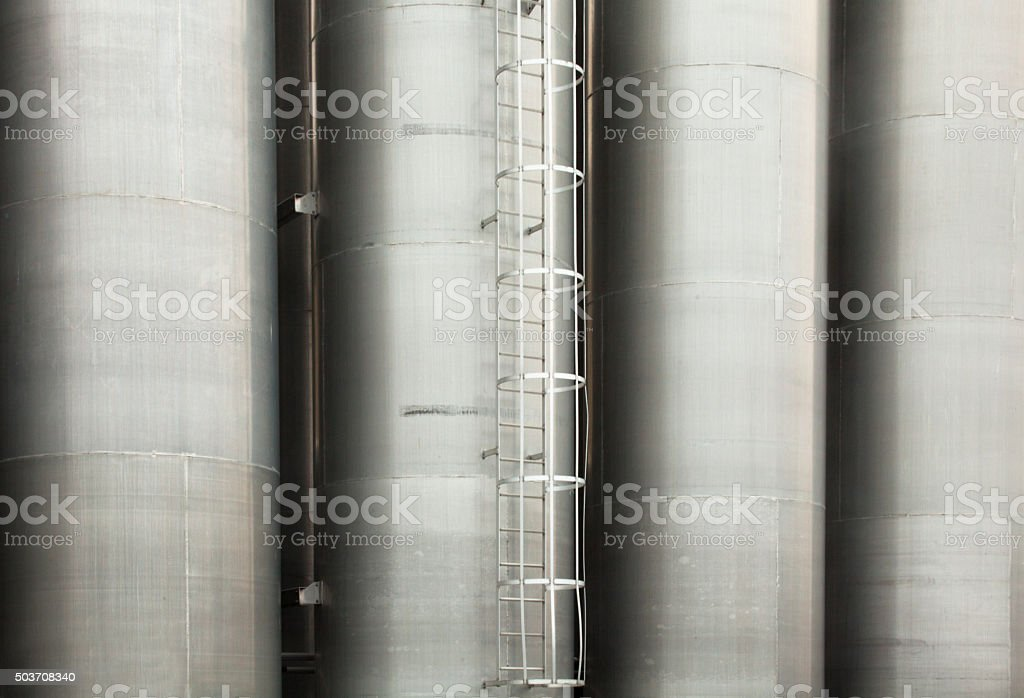 Metal tower silos of the industrial plant stock photo