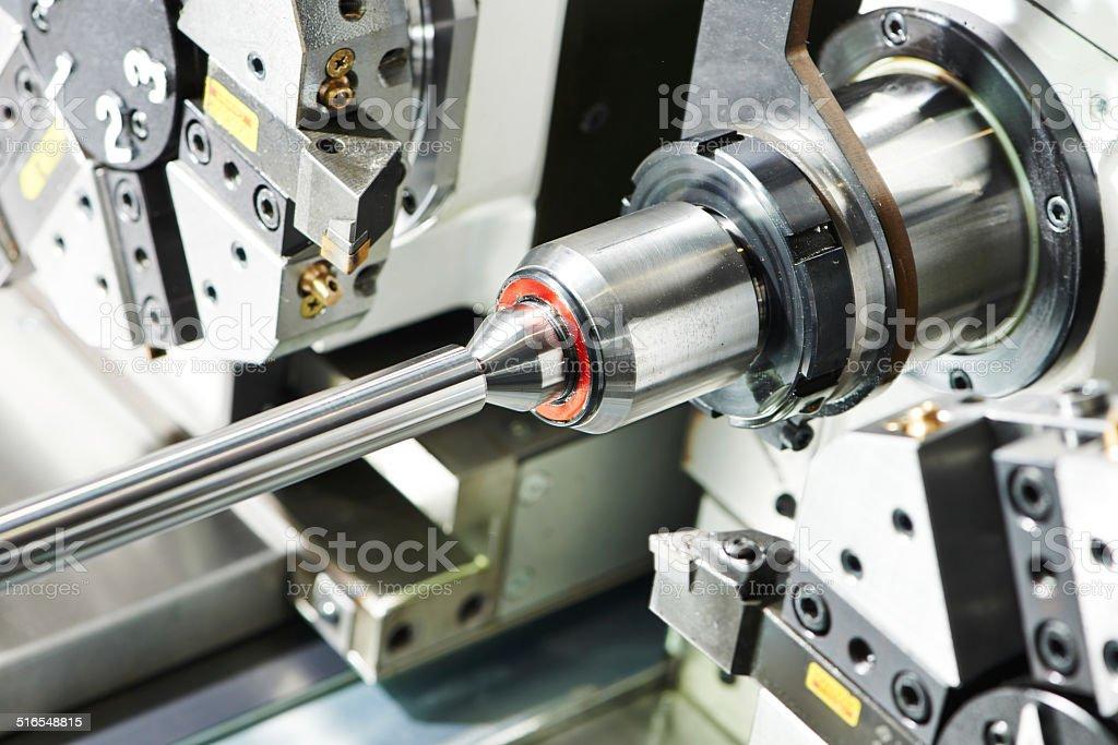 metal turning process on machine tool stock photo