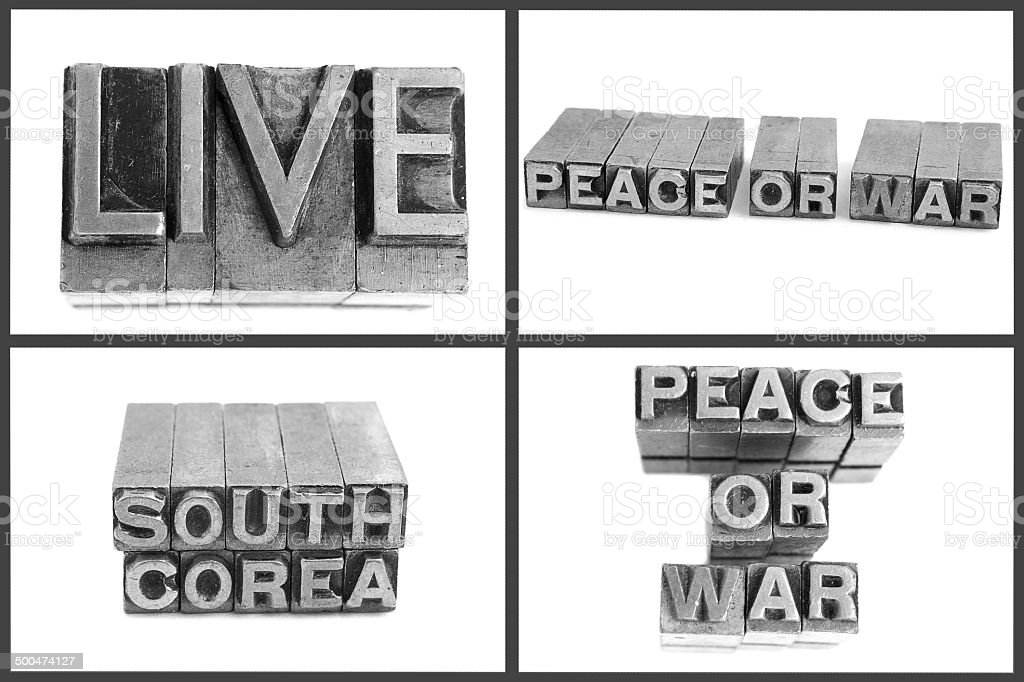 metal type text live, peace or war, south corea stock photo