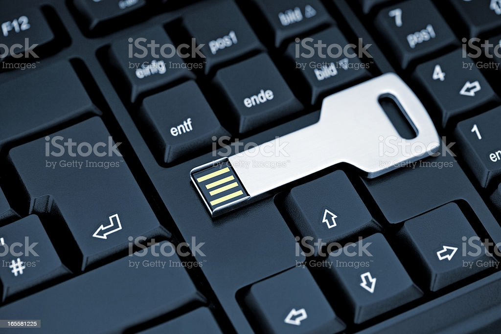 Metal USB flash storage Key on black Keyboard stock photo