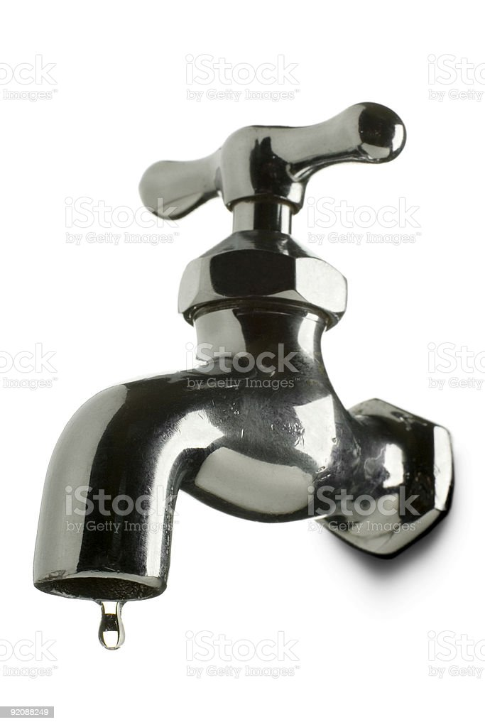 Metal used tap with a drop comming out of it royalty-free stock photo