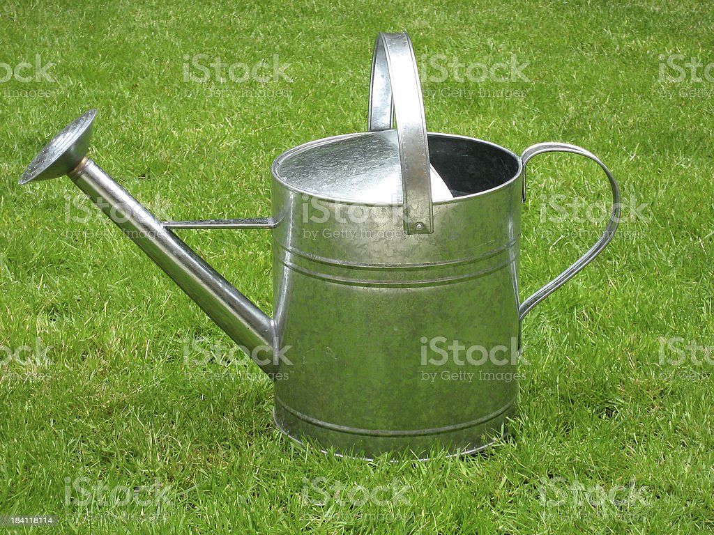 Metal watering can royalty-free stock photo