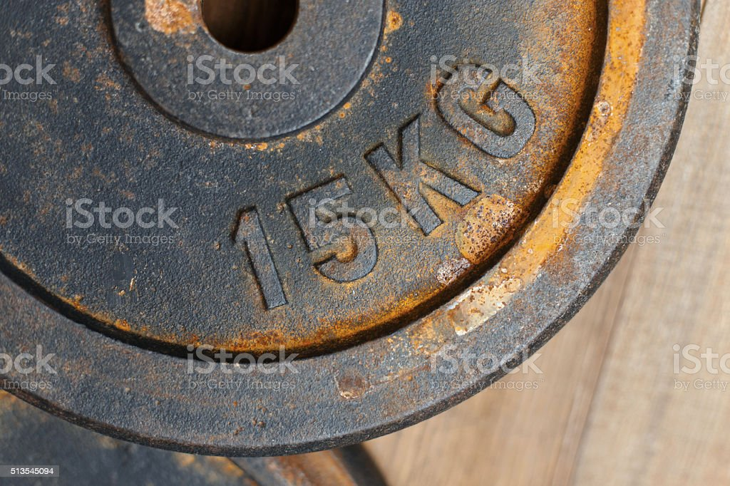 Metal weight 15 kg with rust for the bench stock photo