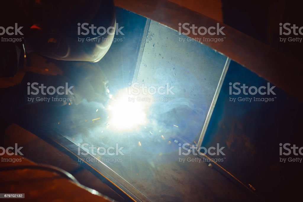 Metal Welding with sparks and smoke stock photo