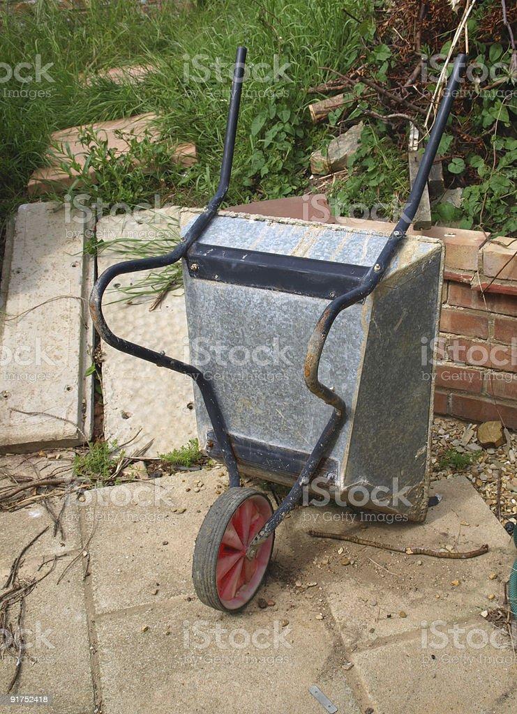 Metal Wheelbarrow, upturned stock photo