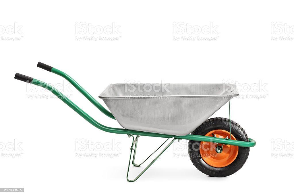 Metal wheelbarrow with green handles stock photo