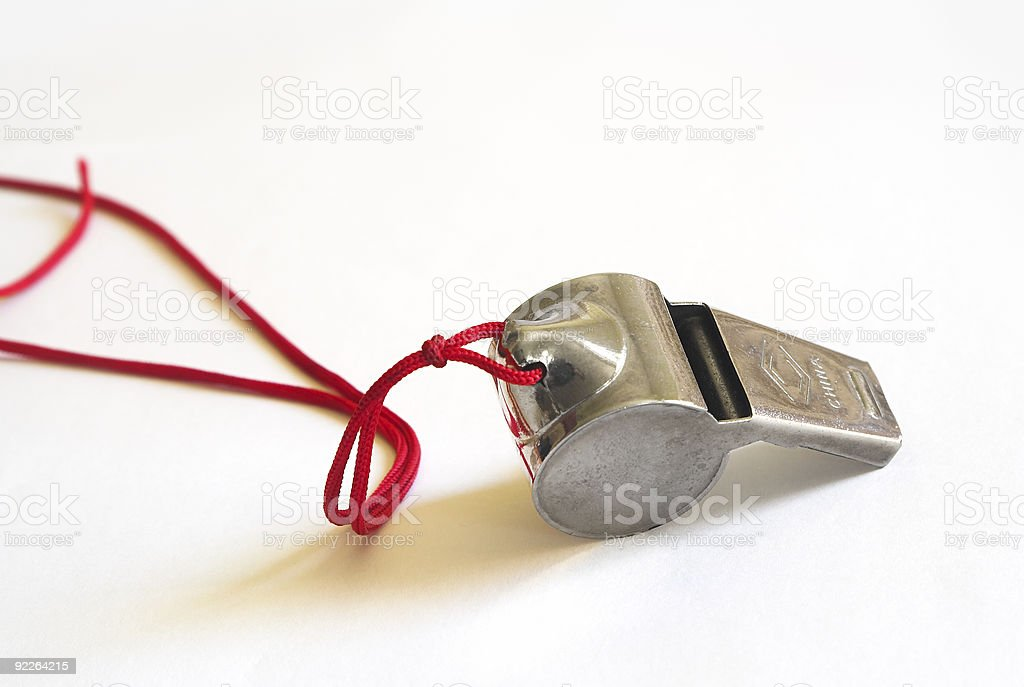Metal whistle on a red cord stock photo