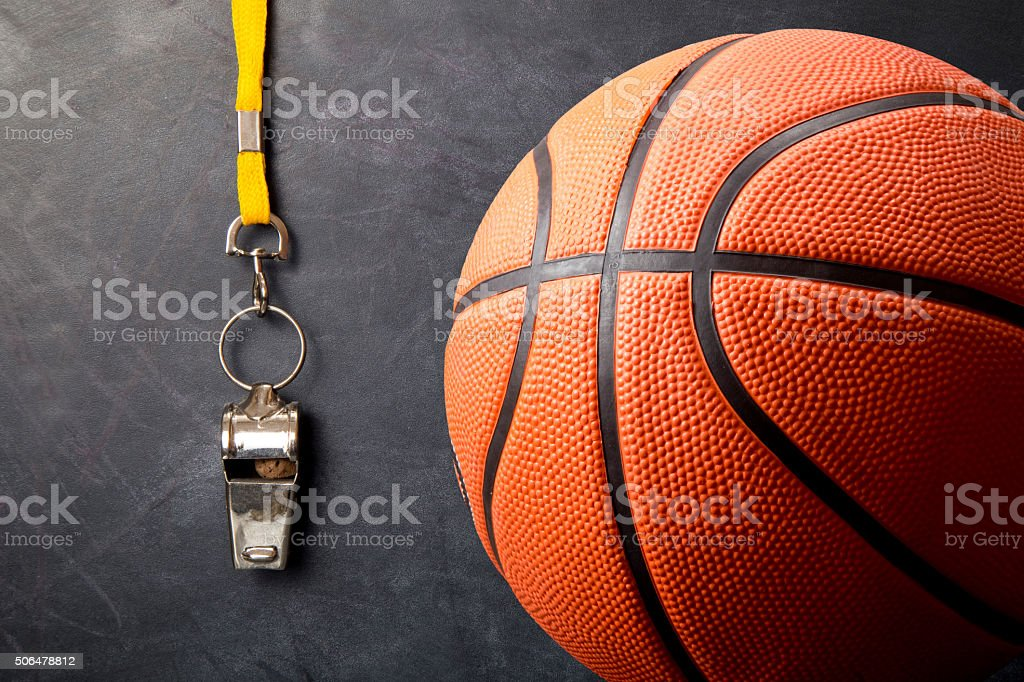 Metal whistle with basketball against blackboard stock photo