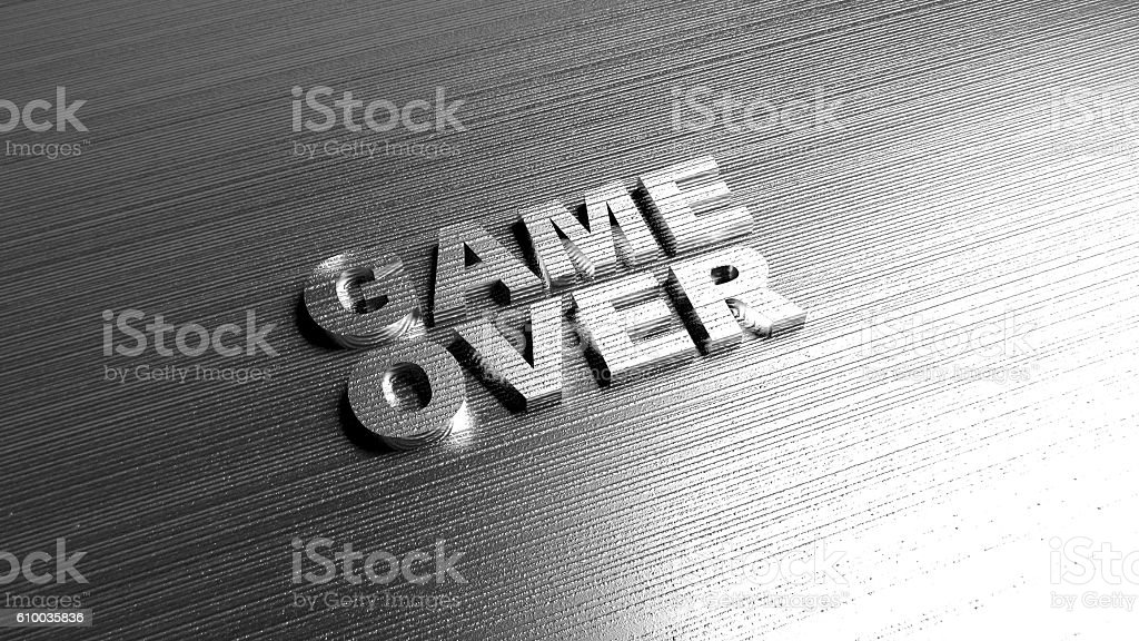 Metal words 'Game over' on metal surface stock photo