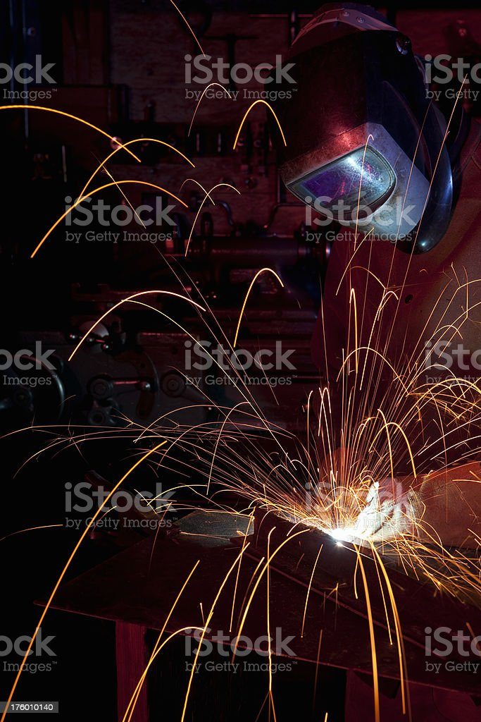 Metal worker welding royalty-free stock photo
