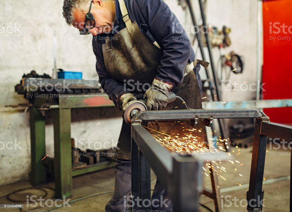 Metal Worker Working in factory stock photo