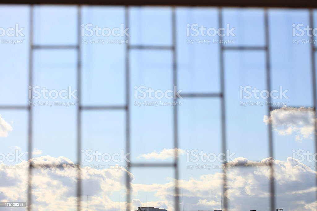 Metallic bars with blue sky background storm, tempest royalty-free stock photo