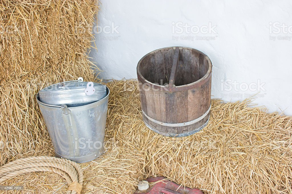 Metallic bucket and wooden on rice hay. royalty-free stock photo
