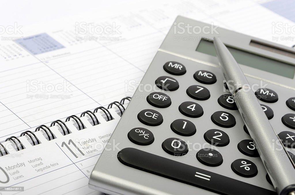 Metallic calculator, pen and organizer royalty-free stock photo
