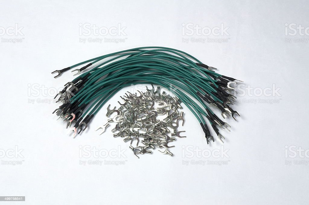Metallic cleats and green wires royalty-free stock photo