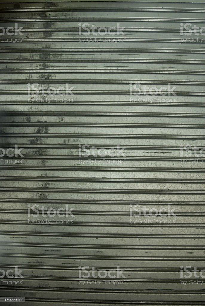 Metallic corrugated curtain textured background royalty-free stock photo