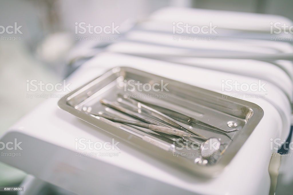Metallic dentist tools close up in a dentist clinic. stock photo