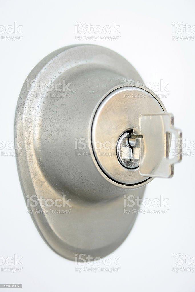 Metallic door lock with a key stock photo