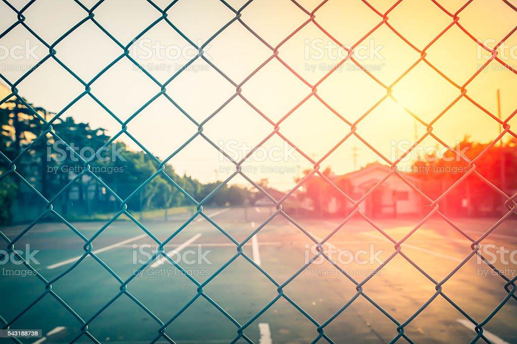 metallic fence at the sunset stock photo