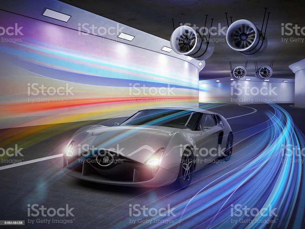 Metallic gray sports car  in the tunnel stock photo