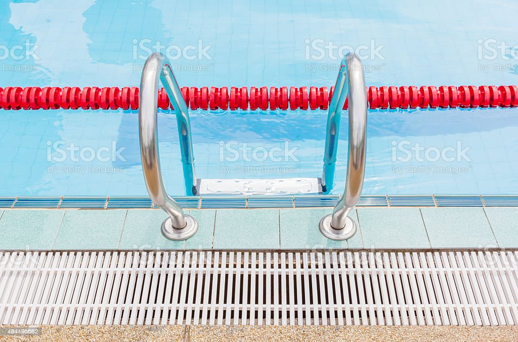Metallic ladder closes with red marked lanes swimming pool. stock photo