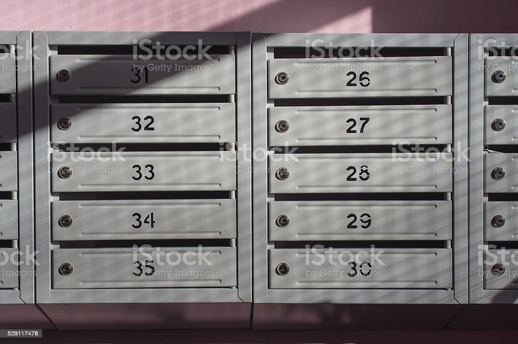 metallic mailbox array tidy inside apartment houses stock photo