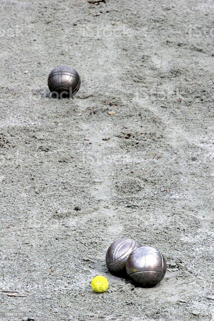 Metallic petanque balls in the sand stock photo
