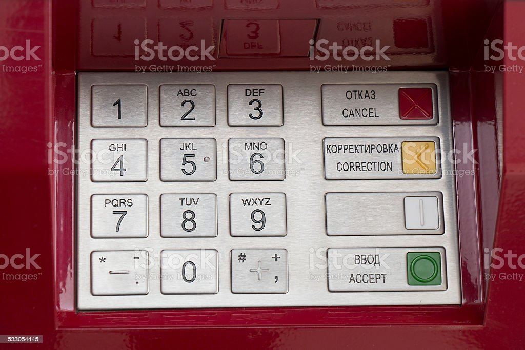 Metallic pinpad ATM on a red background stock photo