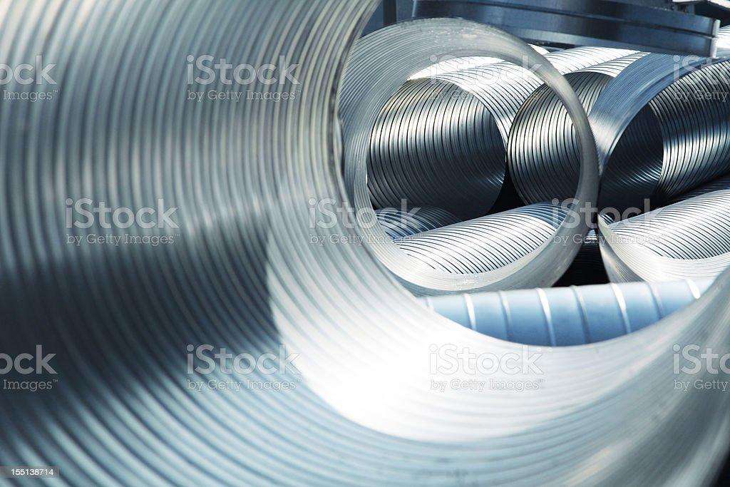 Metallic, ribbed ventilation tubes stock photo