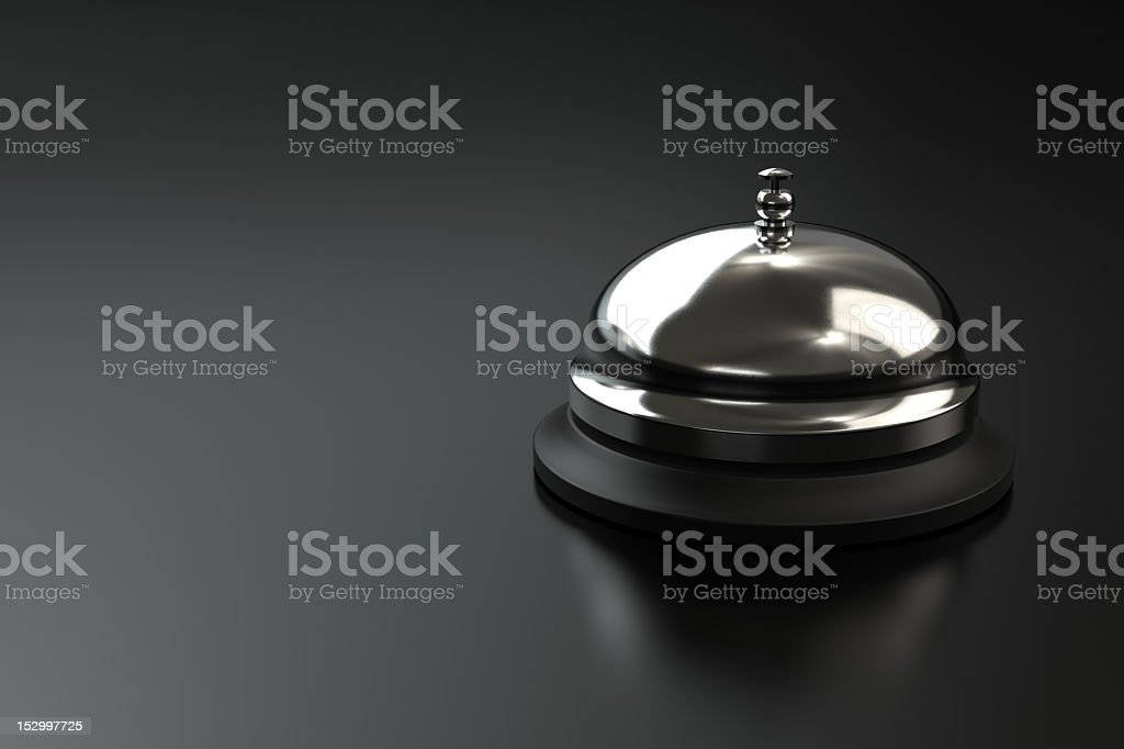 A metallic service bell on a gray background royalty-free stock photo