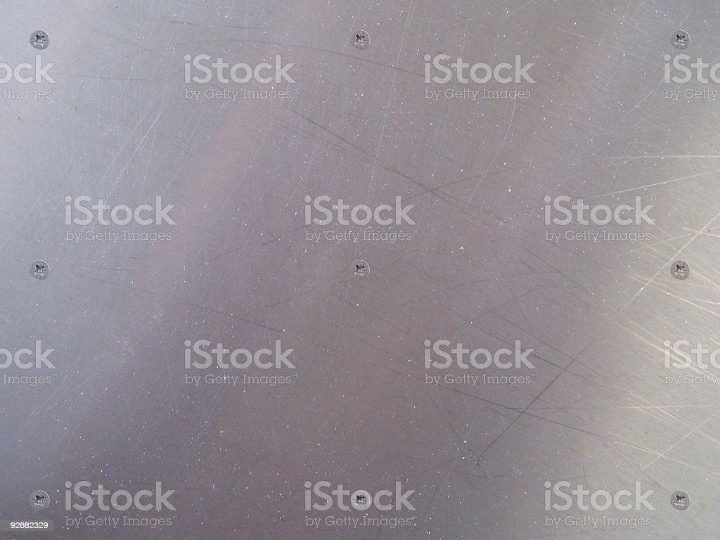 Metallic surface with screws royalty-free stock photo