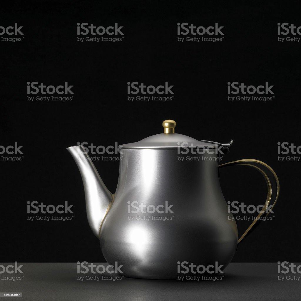 metallic tea pot stock photo