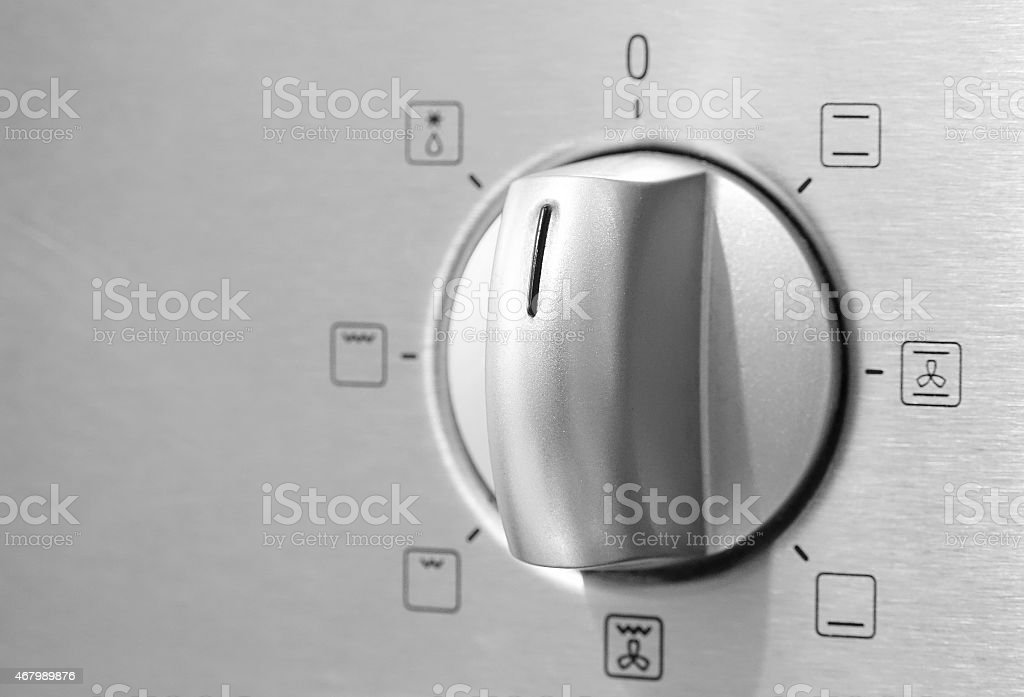 Metallic Toggle Switch of Cooker Oven. Close-up View stock photo