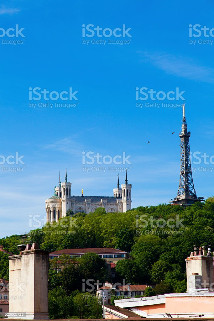 Metallic tower and Basilica of Notre-Dame on the Fourvière Hill stock photo