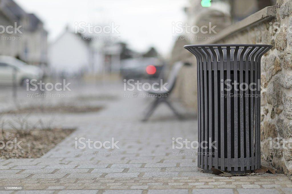 metallic trash bin in a urban environment stock photo