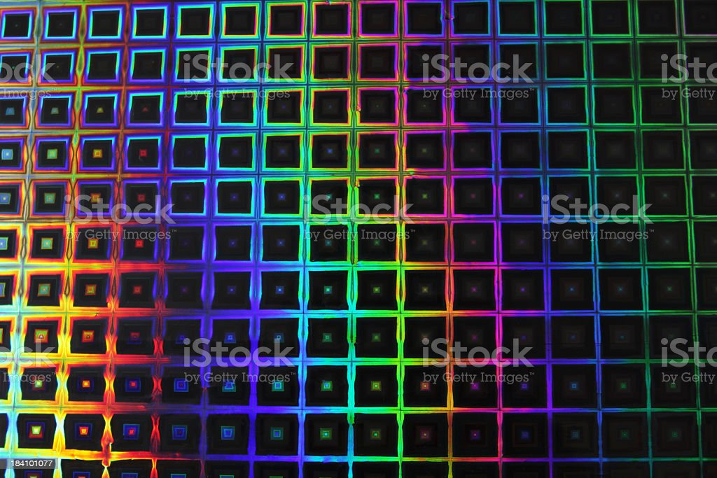 Metallic wrapping paper lit for a rainbow effect royalty-free stock photo