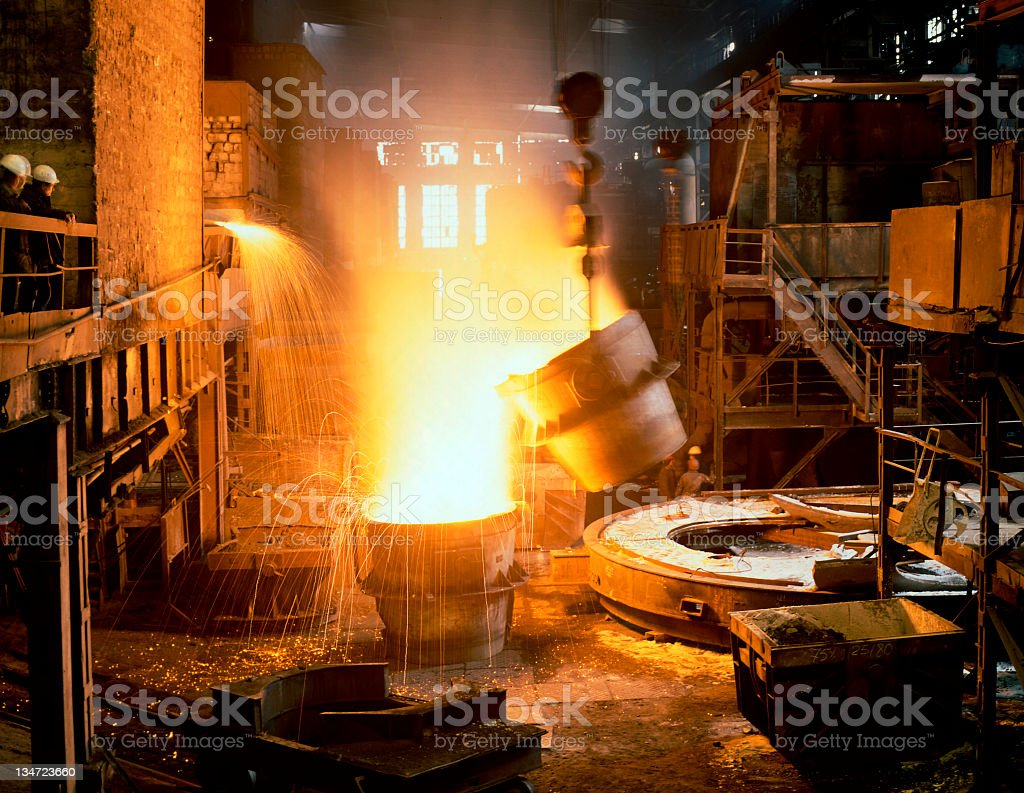 Metallurgy scene in industry with sparks from metal stock photo