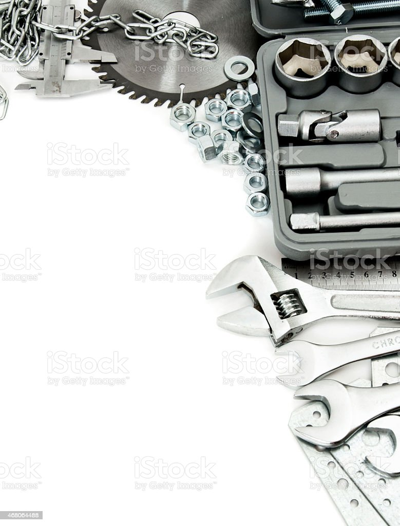 Metalwork. Box, saw, spanner and others tools on white background stock photo